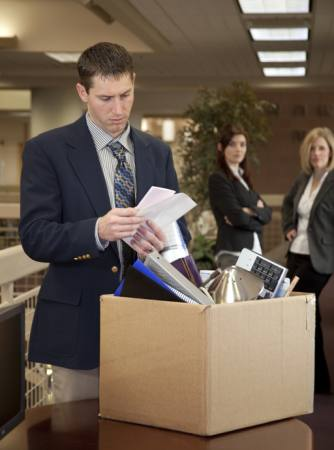 office, box, sad, man, women Justnowimages - Dreamstime