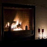 Pixwords The image with fire, fireplace, glasses, glass, wine, window, wood Marcin Winnicki (Frui)